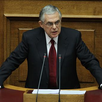 Greek prime minister Lucas Papademos delivers a speech at the Greek parliament in Athens (AP)
