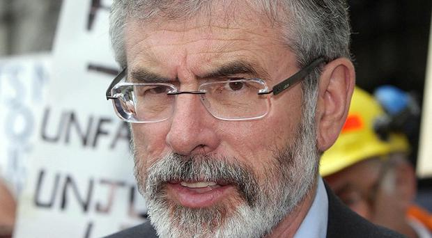 Sinn Fein's Gerry Adams said it was 'a disgrace' after a sitting TD was paid his pension in another financial blunder