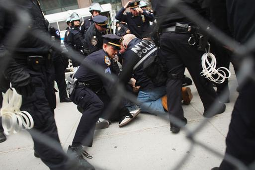 NEW YORK, NY - NOVEMBER 15: A man is arrested as police clear of Occupy Wall Street protesters outside the private park next to Juan Pablo Duarte square following their early morning eviction from Zuccotti Park on November 15, 2011. Hundreds of protesters, who rallied against inequality in America, have slept in tents and under tarps since Sept. 17 in Zuccotti Park. Zuccotti Park became the epicenter of the global Occupy Wall Street movement (Photo by Spencer Platt/Getty Images)