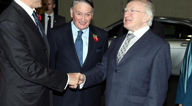New President of Ireland Michael D Higgins is welcomed to Londonderry by Northern Ireland Secretary Owen Paterson (left) and Don Keegan, High Sheriff of Londonderry