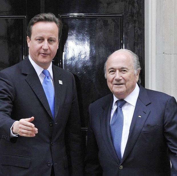 David Cameron has backed calls for Fifa president Sepp Blatter to quit
