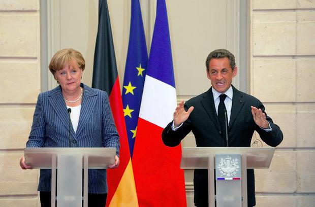 At their mercy: Angela Merkel, Nicolas Sarkozy and George Osborne could have more influence on us than our Executive