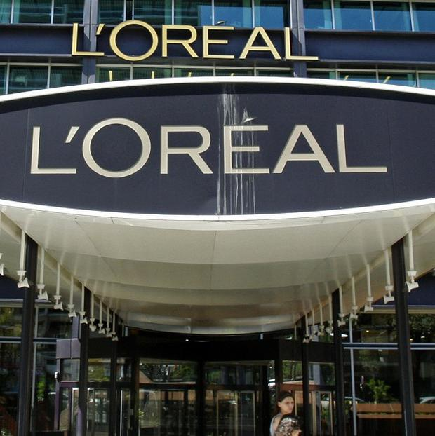 Cosmetic giant L'Oreal has vowed to help an investigation into why a woman collapsed while using one of their home hair dyes (AP)