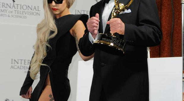 Lady Gaga and award winner Nigel Lythgoe attend the 39th International Emmy Awards