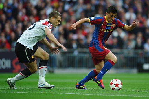 Manchester United captain Nemanja Vidic (left) can only watch Barcelona's David Villa as he marvels the watching world with his trickery during last season's Champions League final