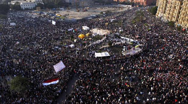 Protesters gather in Tahrir Square in Cairo (AP)