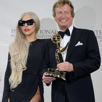 Lady Gaga presented Nigel Lythgoe with the Founders Award at the Emmys (AP)