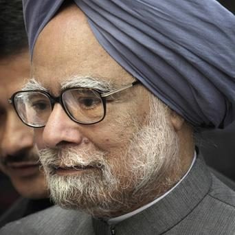 Indian Prime Minister Manmohan Singh arrives on the first day of the winter session of the parliament in New Delhi (AP)