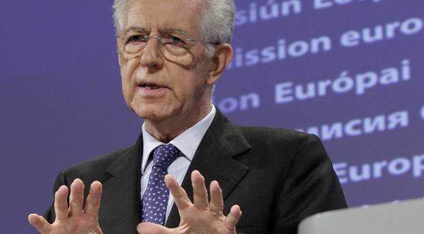 New Italian Prime Minister Mario Monti has won public support, according to a new poll (AP)