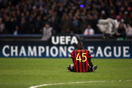 NAPLES, ITALY - NOVEMBER 22: Mario Balotelli of Manchester City sits on the ground during the Uefa Champions League Group A match between Napoli and Manchester City at Stadio San Paolo on November 22, 2011 in Naples, Italy. (Photo by Clive Rose/Getty Images)