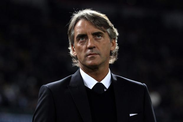 NAPLES, ITALY - NOVEMBER 22: Roberto Mancini of Mancheter City looks on prior to the Uefa Champions League Group A match between Napoli and Manchester City at Stadio San Paolo on November 22, 2011 in Naples, Italy. (Photo by Clive Rose/Getty Images)