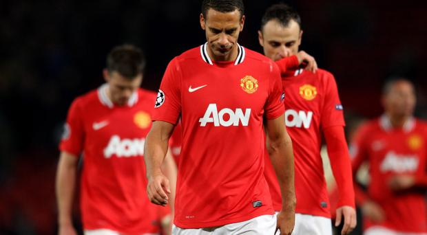 MANCHESTER, ENGLAND - NOVEMBER 22: Rio Ferdinand of Manchester United looks dejected at the end of the UEFA Champions League Group C match between Manchester United and SL Benfica at Old Trafford on November 22, 2011 in Manchester, England. (Photo by Alex Livesey/Getty Images)