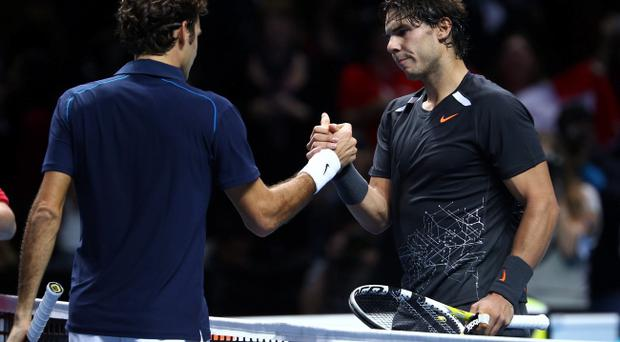 LONDON, ENGLAND - NOVEMBER 22: Rafael Nadal of Spain greets Roger Federer of Switzerland after the men's singles match during the Barclays ATP World Tour Finals at the O2 Arena on November 22, 2011 in London, England. Federar won 6-3 6-0. (Photo by Julian Finney/Getty Images)