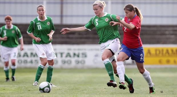 Julie Nelson (centre) is prepared for a fight to the finish as Northern Ireland aim to qualify for the Euro 2013 finals