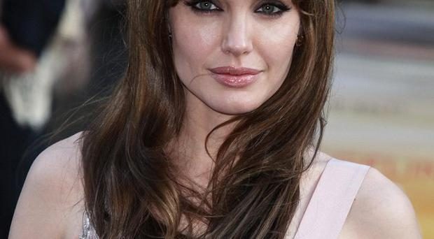 Angelina Jolie says she is lucky to have survived her wild younger days