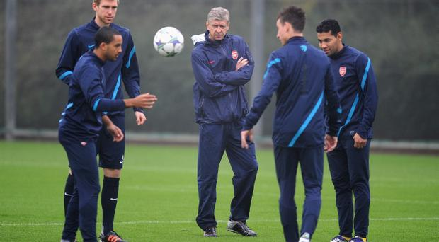 Arsene Wenger takes his players for training yesterday ahead of tonight's Champions League tie with Borussia Dortmund