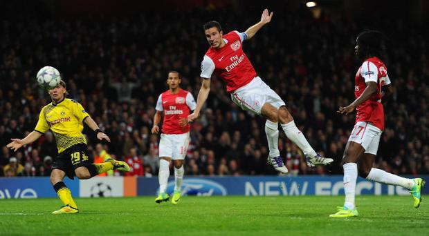 LONDON, ENGLAND - NOVEMBER 23: Robin van Persie of Arsenal heads in the opening goal during the UEFA Champions League Group F match between Arsenal FC and Borussia Dortmund at Emirates Stadium on November 23, 2011 in London, England. (Photo by Mike Hewitt/Getty Images)