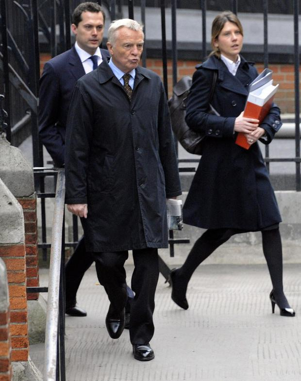 Max Moseley (centre) arrives to give evidence to the Leveson Inquiry at The Royal Courts of Justice, The Strand, London