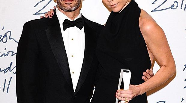 Victoria Beckham with her award and Marc Jacobs at the 2011 British Fashion Awards