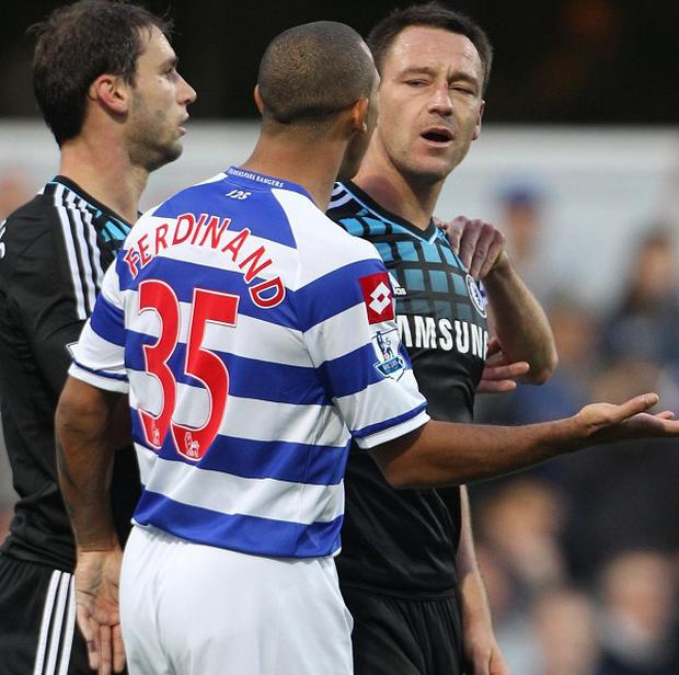 Chelsea footballer John Terry (right) speaks with QPR's Anton Ferdinand during the controversial game at Loftus Road