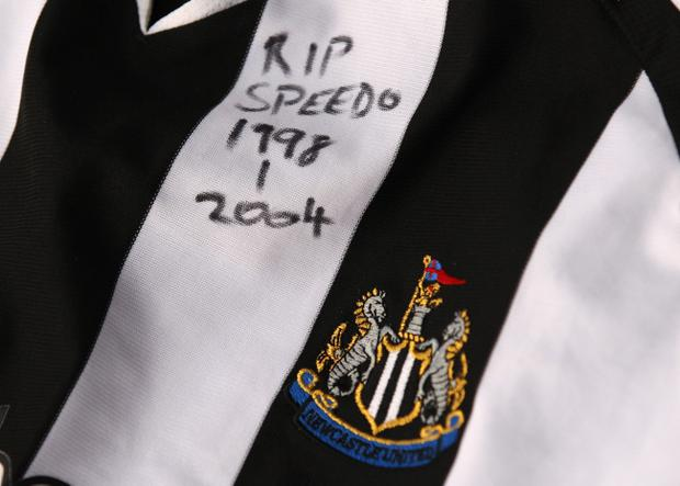 BOLTON, ENGLAND - NOVEMBER 28: A Newcastle United shirt is seen amongst tributes to footballer and ex Bolton Wanderers player Gary Speed outside the Reebok Stadium the home ground of Bolton Wanderers FC on November 28, 2011 in Bolton, United Kingdom. (Photo by Alex Livesey/Getty Images)
