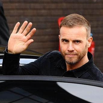 Gary Barlow says The X Factor is 'a very aggressive show to be on'