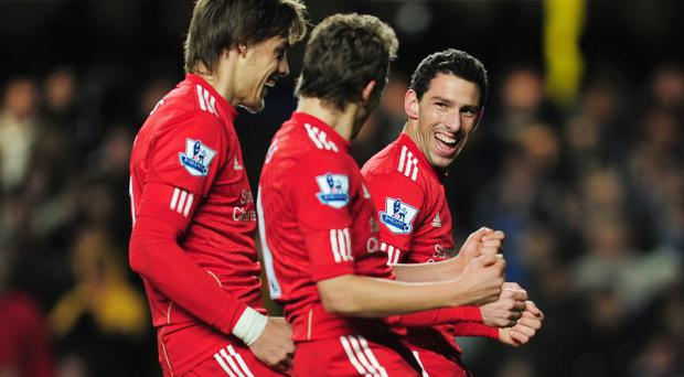 LONDON, UNITED KINGDOM - NOVEMBER 29: Maxi Rodriguez (R) of Liverpool celebrates the opening goal with team mates during the Carling Cup quarter final match between Chelsea and Liverpool at Stamford Bridge on November 29, 2011 in London, England. (Photo by Jamie McDonald/Getty Images)