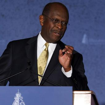 Republican presidential candidate Herman Cain campaigns at Hillsdale College in Michigan (AP)