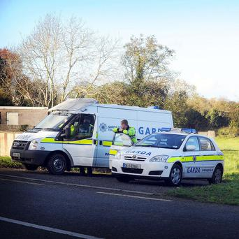 Gardai investigate the site where the remains of 29-year-old Ciaran Noonan were discovered