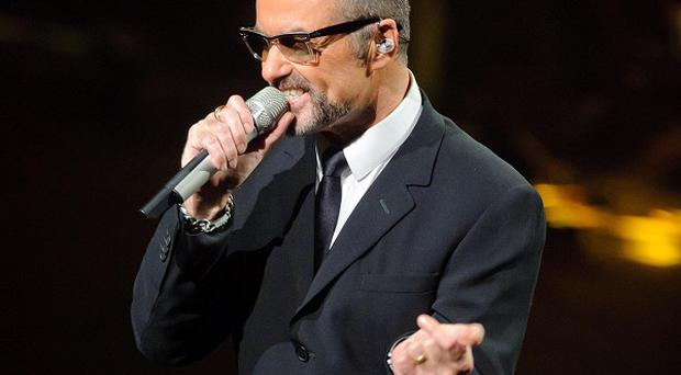 Doctors have said George Michael is improving after he had be taken to hospital with severe pneumonia