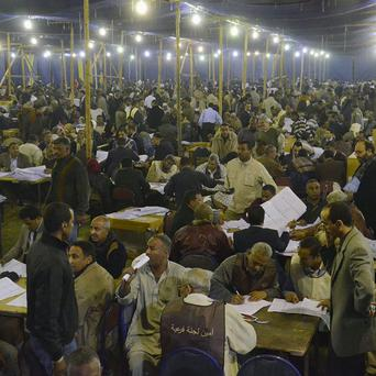 Election workers count ballots for the parliamentary elections in Luxor, Egypt (AP)