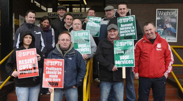 Union members on the picket line at the Waterside Railway Station in Derry which was closed due to the national strike on wednesday. Picture Martin McKeown. 30.11.11