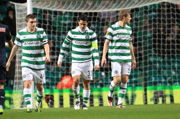 Celtic's James Forrest, Beram Kayal and Glenn Loovens react after conceding a goal during the UEFA Europa League match at Celtic Park, Glasgow
