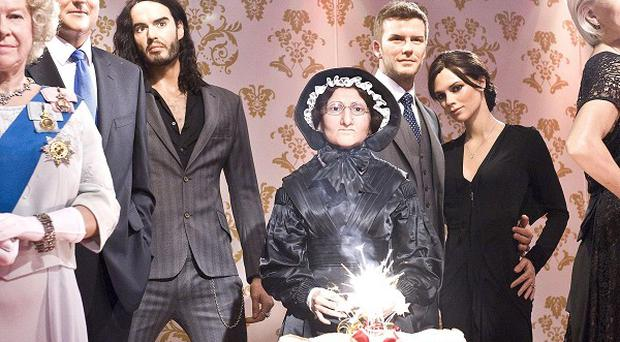 'Posh and Becks' help celebrate a milestone for Madame Tussaud