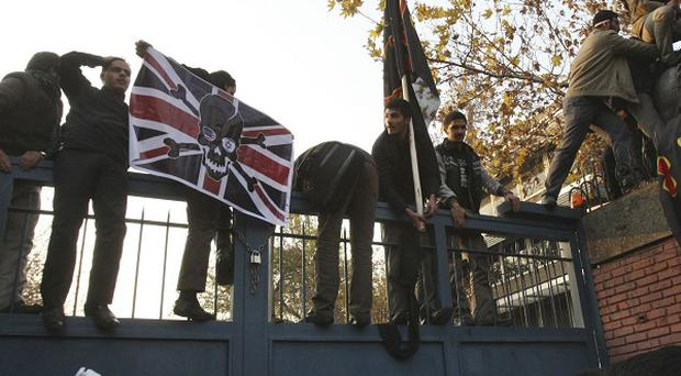 Iranian protesters stormed the British Embassy in Tehran (AP)