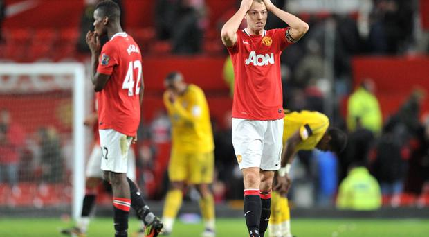 It was head in hands stuff for Manchester United's Jonny Evans in the shock Carling Cup defeat to Crystal Palace on Wednesday night