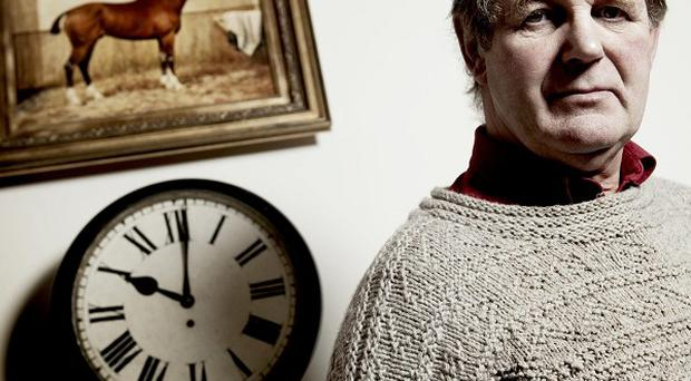 Michael Morpurgo with the painting of Joey the horse