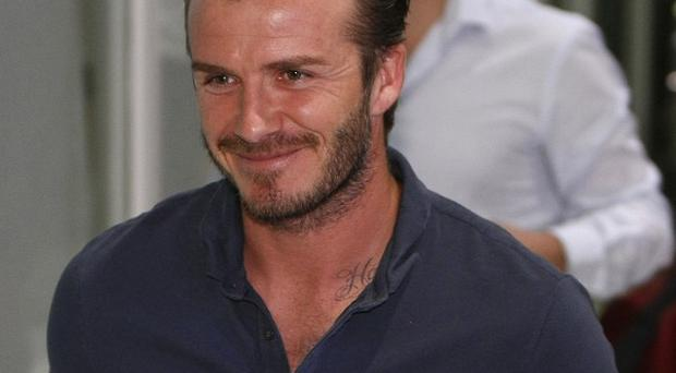 David Beckham took time out to visit disadvantaged children in the Philippines