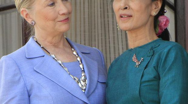 Hillary Clinton and Aung San Suu Kyi hold their hands together after their meeting in Yangon (AP)
