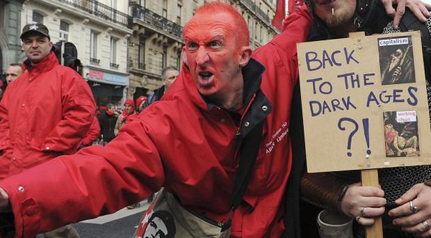 Protesters march through Brussels over austerity measures to be taken by the new Belgian government (AP)