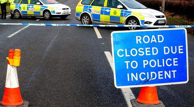 Police have started a probe after two concrete blocks were dropped onto cars from a bridge