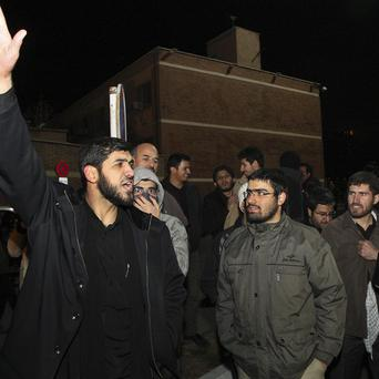 Demonstrators in Tehran welcome home Iranian diplomats expelled from London (AP)