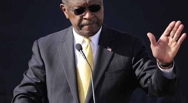 Republican presidential candidate Herman Cain announces he is suspending his campaign (AP)