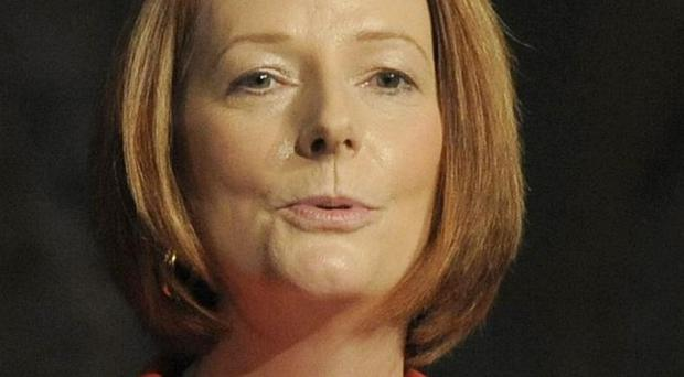 Australia's ruling Labour Party, led by Julia Gillard, has voted to overturn a ban on exporting uranium to India