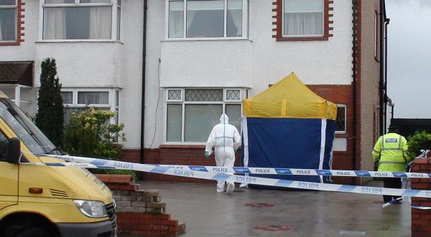 Police in Fairhaven Road, Southport, where two women were found dead