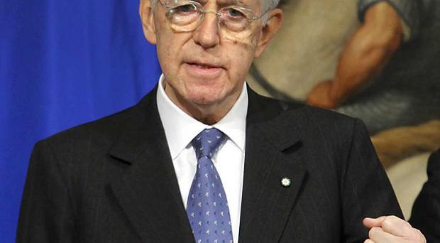 Mario Monti held a cabinet meeting so ministers could approve austerity measures for Italy (AP)