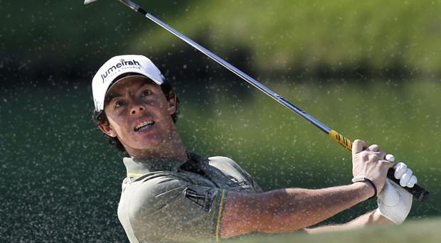 Northern Ireland's Rory McIlroy blasts out of a bunker on the 18th hole at the Hong Kong Open golf tournament in Hong Kong Sunday, Dec. 4, 2011. McIlroy won the tournament with 12-under 268. (AP Photo/Vincent Yu)