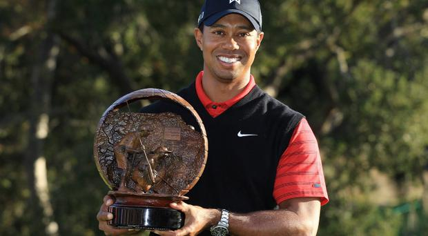 THOUSAND OAKS, CA - DECEMBER 04: Tiger Woods poses with the trophy after winning the Chevron World Challenge at Sherwood Country Club on December 4, 2011 in Thousand Oaks, California. (Photo by Scott Halleran/Getty Images)