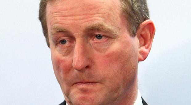 Taoiseach Enda Kenny says spending cuts and tax hikes will be painful