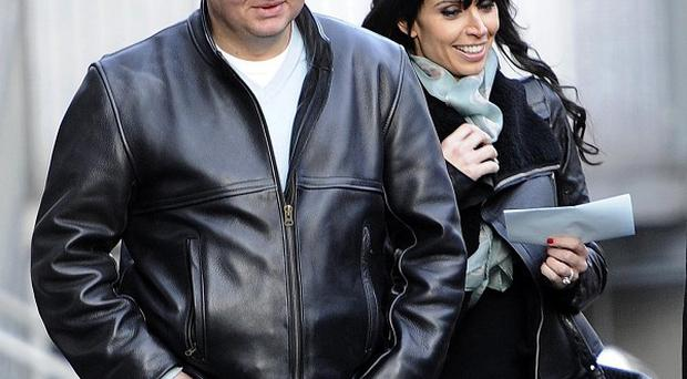 Adrian Chiles and Christine Bleakley leave the studio after filming their last episode of Daybreak